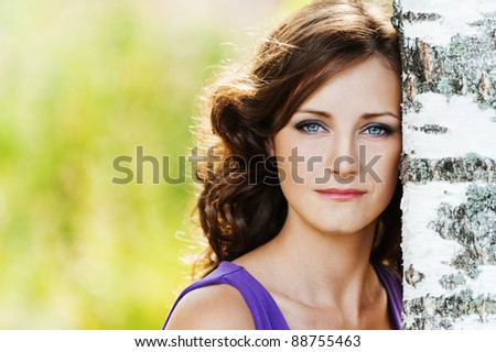 portrait young charming woman sad lonely leaned birch background summer nature - stock photo
