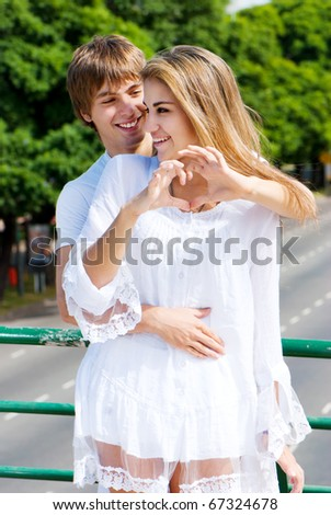Portrait young couple in love in park - stock photo
