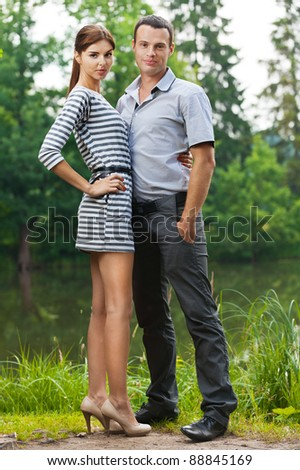 portrait young couple love woman man full-length background pond summer green park - stock photo