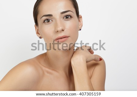 Portrait young female model with clear face and sking opposite white background - stock photo
