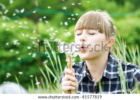 Portrait young girl at the outdoor in the green grass - stock photo