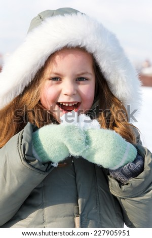 portrait young girl in winter park - stock photo