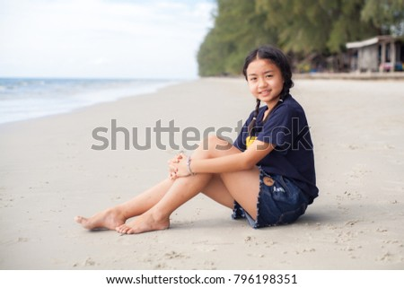 Portrait young girl on the beach
