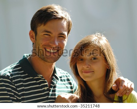 Portrait young,  guy and  girl in  street in  sunny day