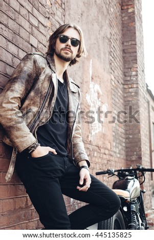 portrait young guy with a beard and mustache with sunglasses posing on the street vintage man, fashion men, hipster street casual motorcycle - stock photo