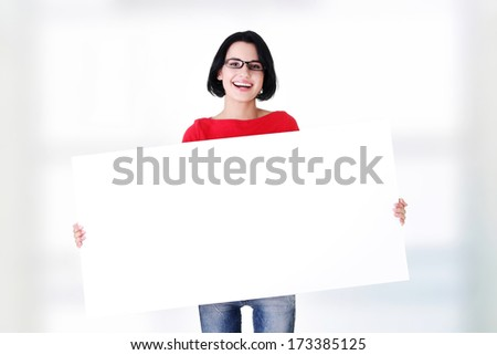 Portrait young happy woman with blank board  - stock photo