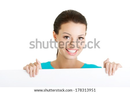 Portrait young happy woman with blank board , isolated on white - stock photo