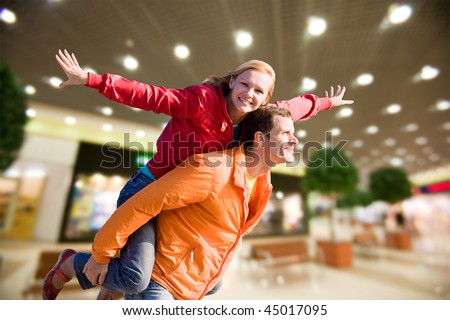 Portrait Young love Couple smiling under interior shop - stock photo