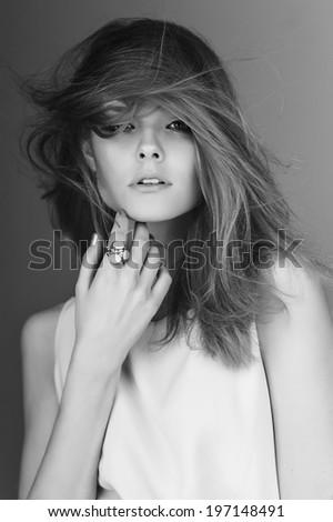 portrait young sensual model girl pose in studio. Black-white photo. - stock photo