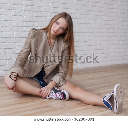 portrait young sexy woman in jeans shorts