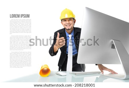 portrait young Thai engineer working with computer - stock photo