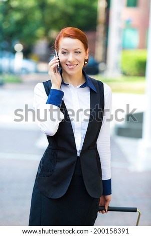 Portrait young urban happy businesswoman on smart phone running in street talking on smartphone smiling wearing jacket, carrying luggage bag on Washington DC streets USA. Corporate life travel concept - stock photo
