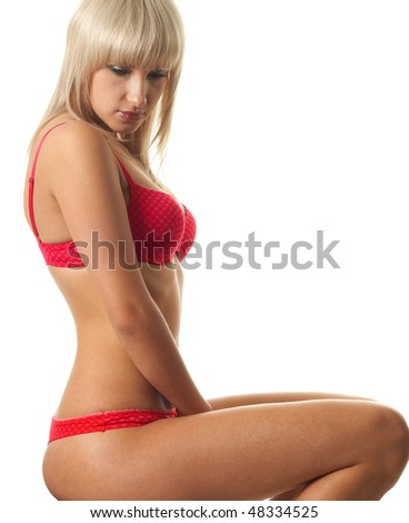Portrait young woman in red underwear against white background - stock photo