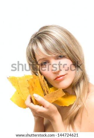 Portrait young woman with fall leafs isolated on white - stock photo