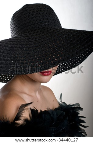 Portrait young women in black hat - stock photo
