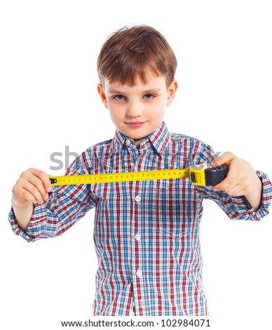 Portraite of cute boy with a building roulette. Isolated on white backrownd. - stock photo