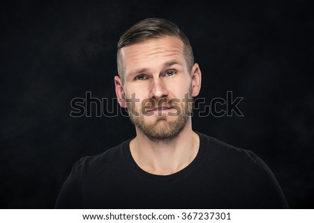 Portraite of funny man  on a dark background. - stock photo