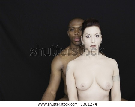 Portraits in contrast in nude on black - stock photo