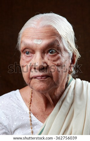 Portraits of an Indian senior woman with an anxious face - stock photo
