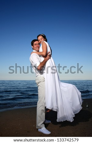 portraits of bride and groom at the beach