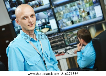 Portraits of security guard over video monitoring surveillance security system - stock photo