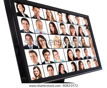 Portraits of smiling people on a computer monitor - stock photo