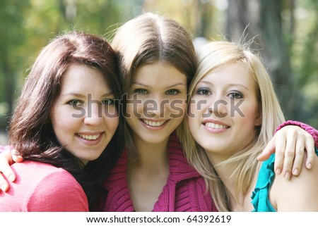 Portraits of three smiling girls
