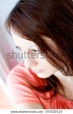 Portrat of a young adult woman, shallow DOF - stock photo