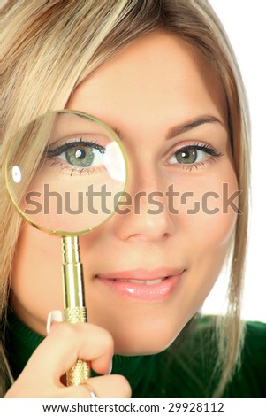 Portrat of a young woman looking through the magnifying glass