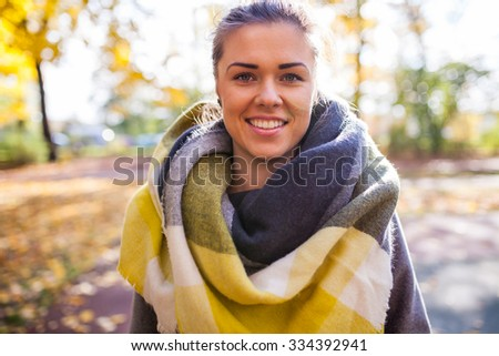 Portret of a beautiful young girl in park. Autumn time - stock photo