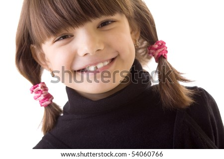 portret of a face Little happy beautiful girl  with ponytails - stock photo