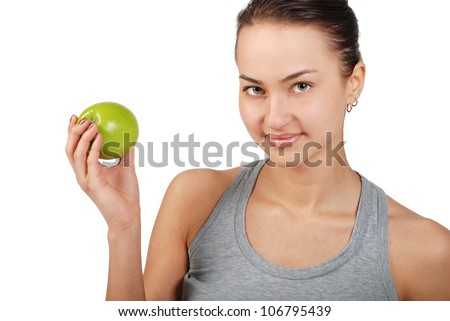 Portret of young beautiful women with green apple