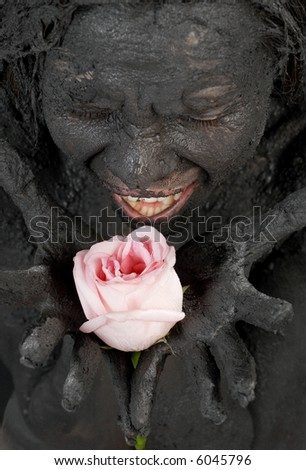 portrit of crying dirty girl holding pink rose - stock photo