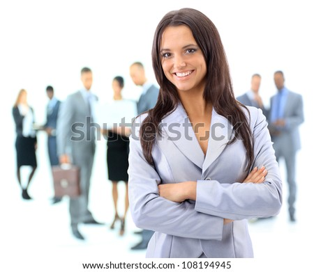 Portrrait of a young business woman with people discussing in background - stock photo