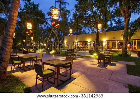 portrtait of beautiful outdoor and indoor restaurant view in night illumination - stock photo