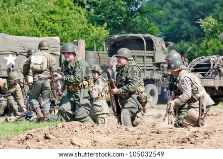 PORTSMOUTH, ENGLAND - JUNE 3: USA and German Army re-enactment groups play out simulated WW2 war games, using period uniforms, weapons & vehicles at the Overlord event on June 3, 2012 at Portsmouth