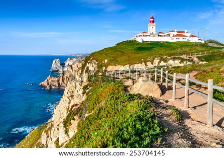 Portugal. Cabo da Roca and the lighthouse over Atlantic Ocean, the most westerly point of the European mainland. - stock photo