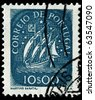 PORTUGAL - CIRCA 1943: A stamp printed in Portugal shows sail ship, circa 1943. This stamp represents the caravel, the Portuguese naval creation of the 1400s that revolutionized ocean navigation. - stock photo
