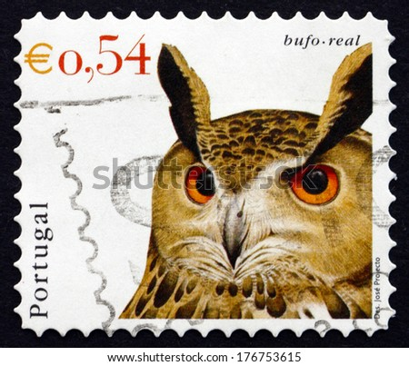PORTUGAL - CIRCA 2002: a stamp printed in the Portugal shows Eurasian Eagle Owl, Bubo Bubo, Bird, circa 2002 - stock photo