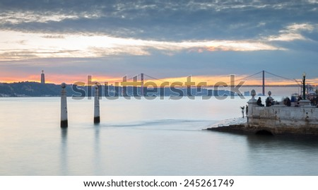 Portugal, Europe - The Columns Wharf Viewpoint at commerce square downtown at sunset in city of Lisbon (panorama-long exposure) - stock photo