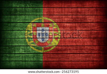Portugal flag pattern on wooden board texture ,retro vintage style - stock photo