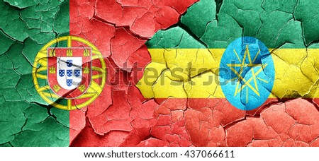 Portugal flag with Ethiopia flag on a grunge cracked wall - stock photo