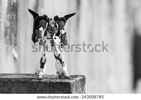 Portugal - January 5, 2015 : Figure of Z-Gundam MSZ-006 from Tamashii Nations & Bandai animations, standing on a rock, in my outdoor garden, Povoa de Lanhoso - stock photo