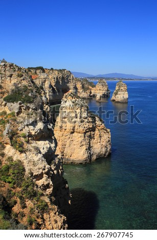 Portugal, Lagos, Western Algarve View of cliffs and small secluded beaches. - stock photo