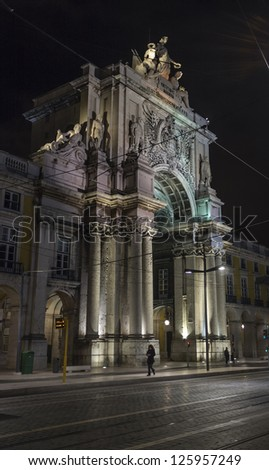 Portugal, Lisbon, Baixa area,  Market Square, view of the Triumph Arch at night - stock photo