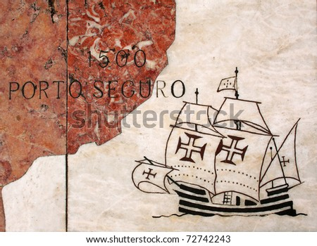 "Portugal Lisbon Belem Detail of huge wind rose laid in marble depicting the Portuguese discovery expeditions - Caravel ""caravela"" Arriving at Port Seguro Brazil - stock photo"