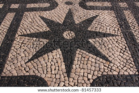 """Portugal Lisbon Typical old  Portuguese black and white mosaic """"calcada"""" pavement - stock photo"""