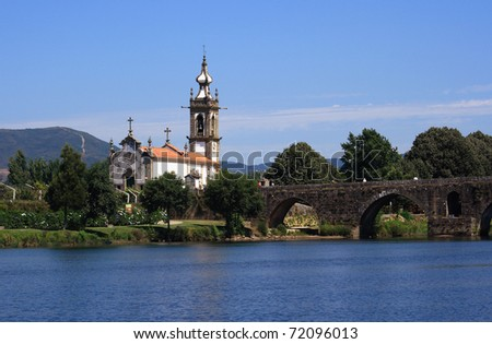 Portugal Minho Region Ponte de Lima Baroque church and Roman Bridge reflecting on the River Lima - stock photo
