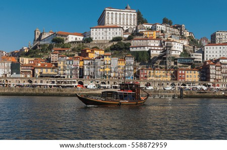 Portugal, Porto - OCTOBER 14, 2016: View of the city of Porto and the ships sailing on the river Douro