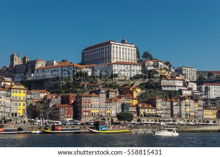 Portugal, Porto - OCTOBER 14, 2016: View of the city of Porto with a boat floating on the river Douro